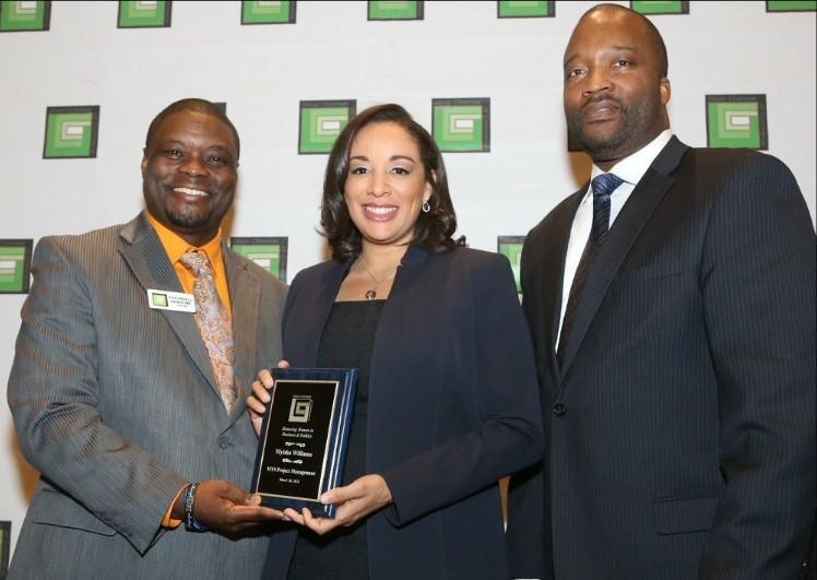 Myisha receiving award